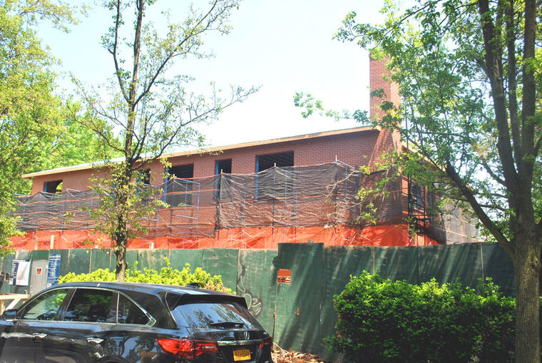 A cavernous two-story home being built in Broadway-Flushing, planned to have 10 bathrooms and eight bedrooms, has caused concern in the area, with some frustrated by the city declining to give over amended building plans for it.